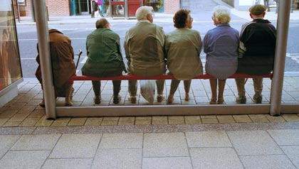 Senior people waiting at bus stop