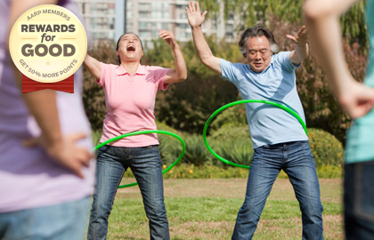 An older couple hula hooping