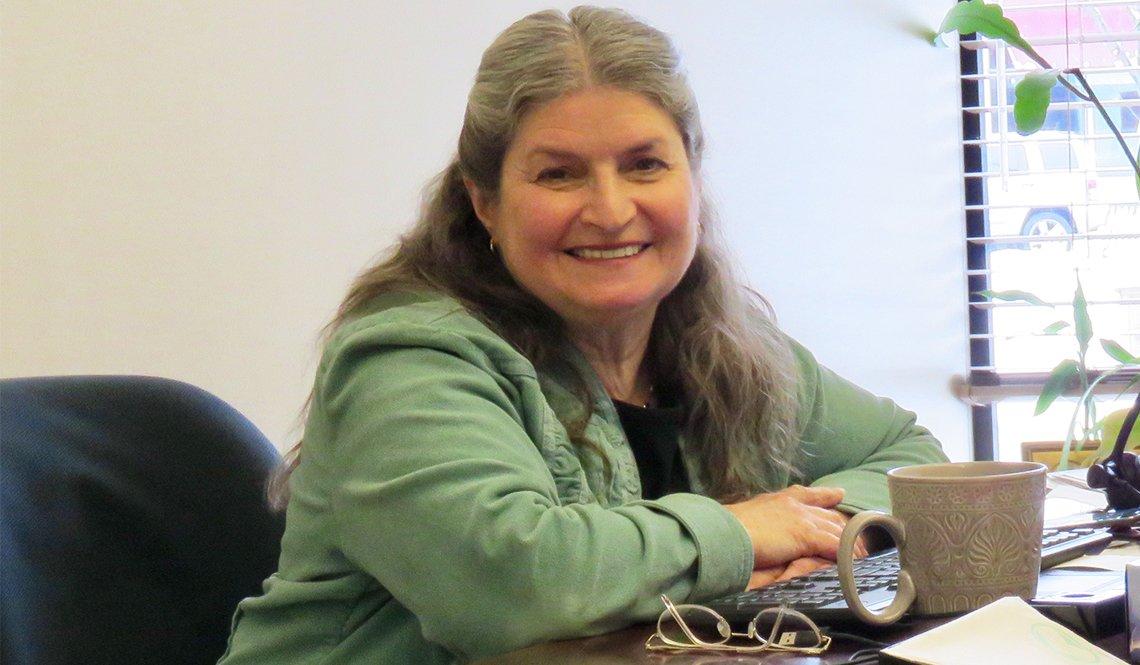 ITN America founder Katherine Freund at her desk