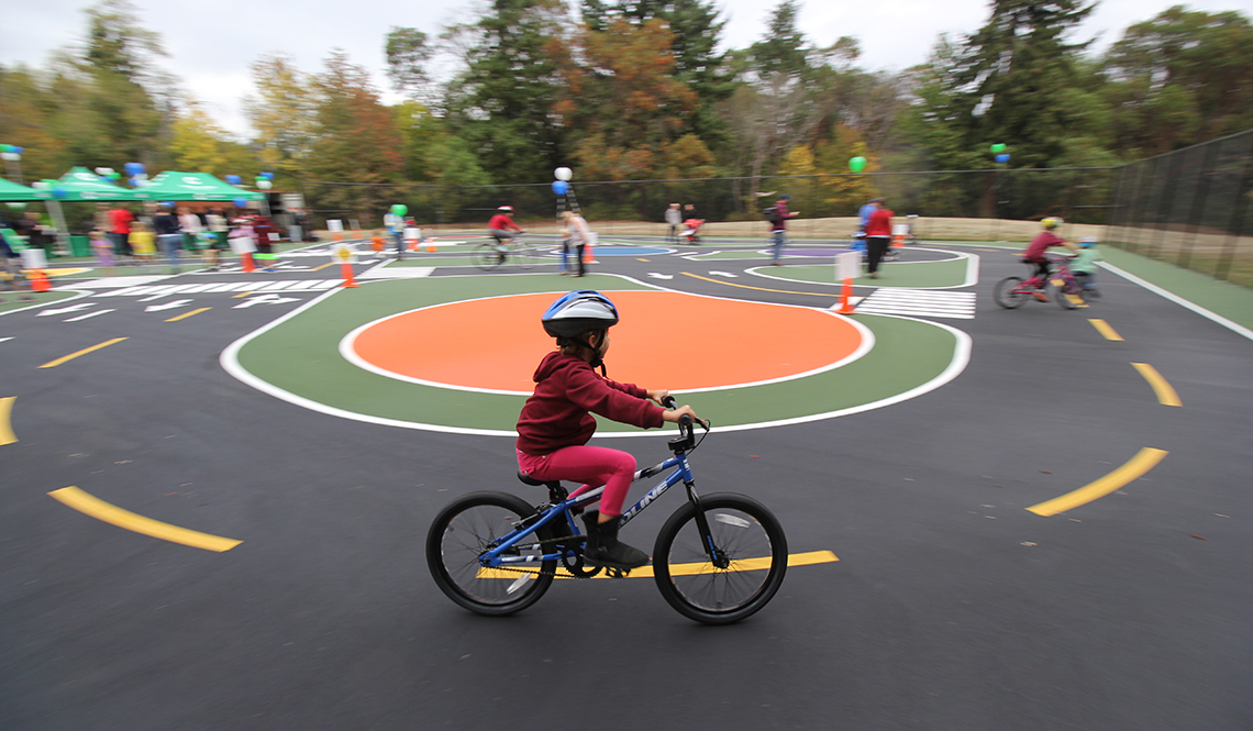 A child practices riding a bicycle in a Bike Safety Park near Seattle, Washington