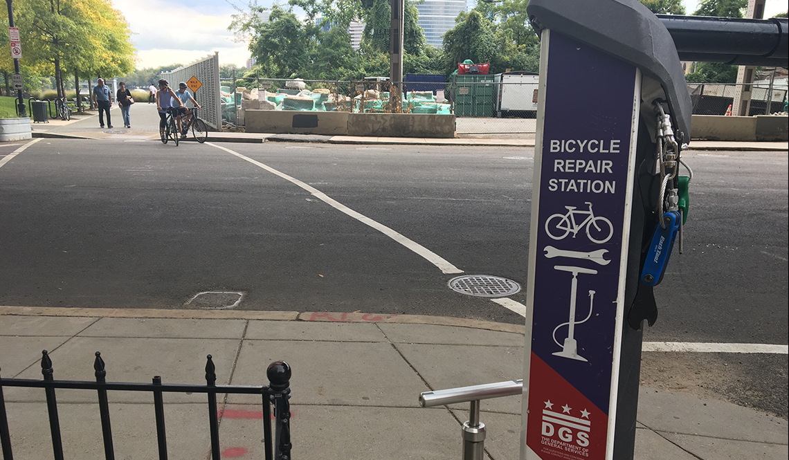 A bicycle repair kiosk in Washington DC includes tools bicyclists need for emergency repairs