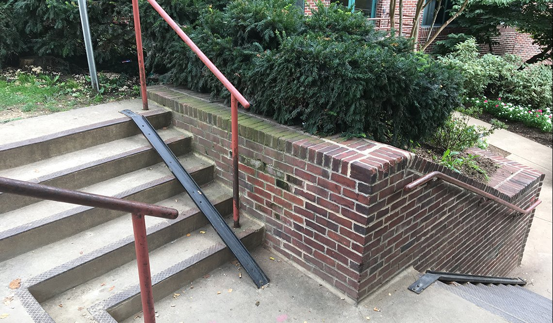 A narrow, metal bicycle ramp in Washington DC enables cyclists to roll rather than carry their bicycle down a flight of stairs