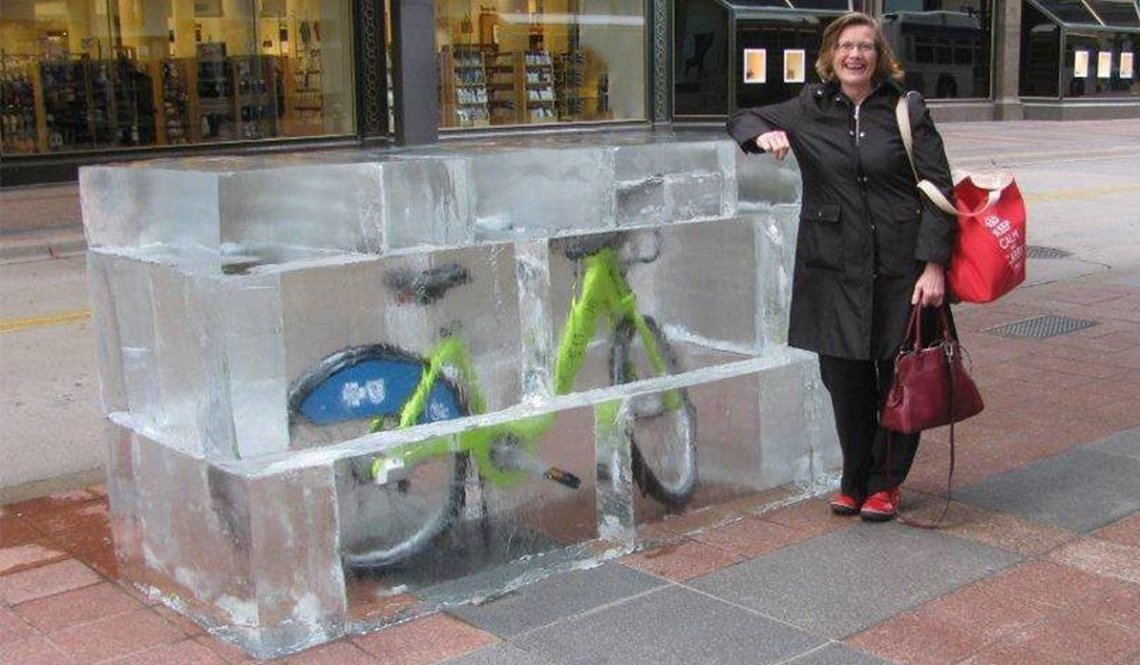 Minneapolis resident Phyllis Rodan poses next to a Nice Ride bike-share bicycle encased in fake ice
