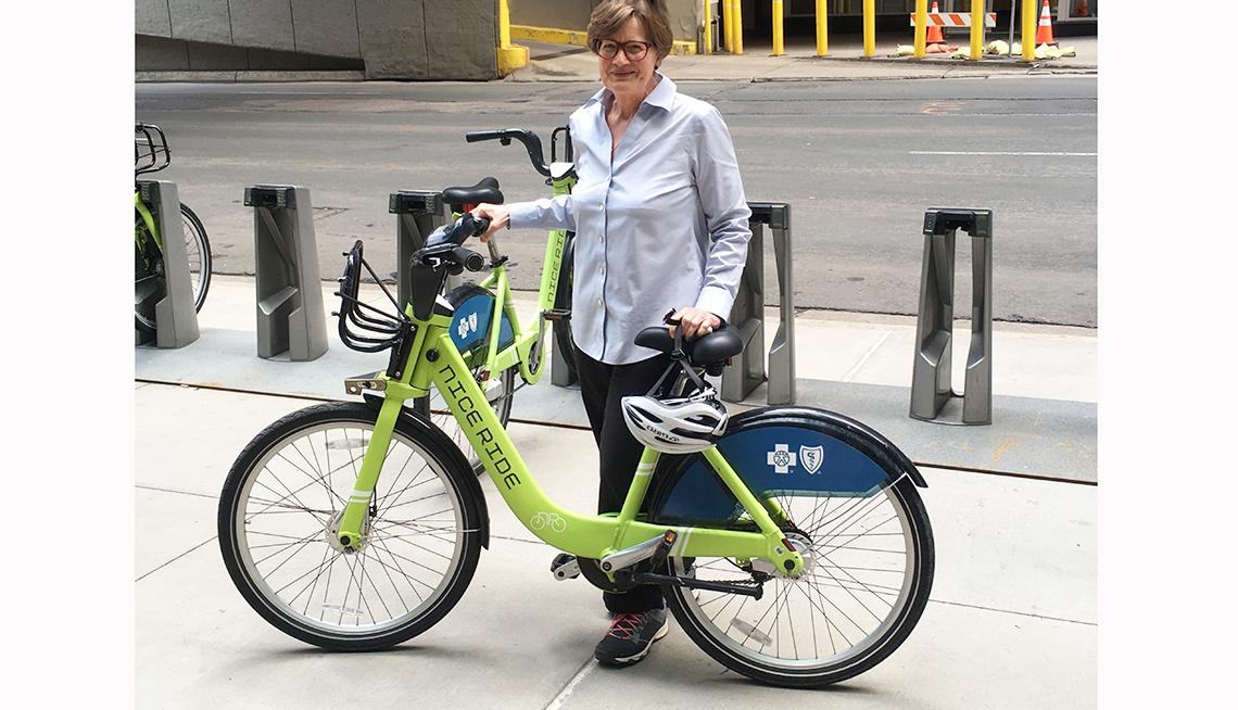 Minneapolis resident Phyllis Rodan poses next to a Nice Ride bike-share bicycle
