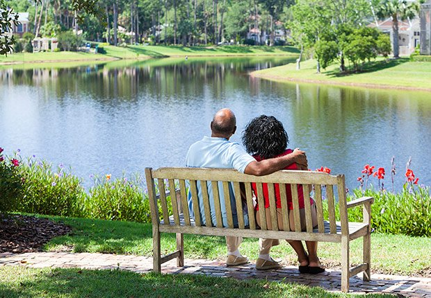 Couple sitting on bench looking at water, Livable Communities.