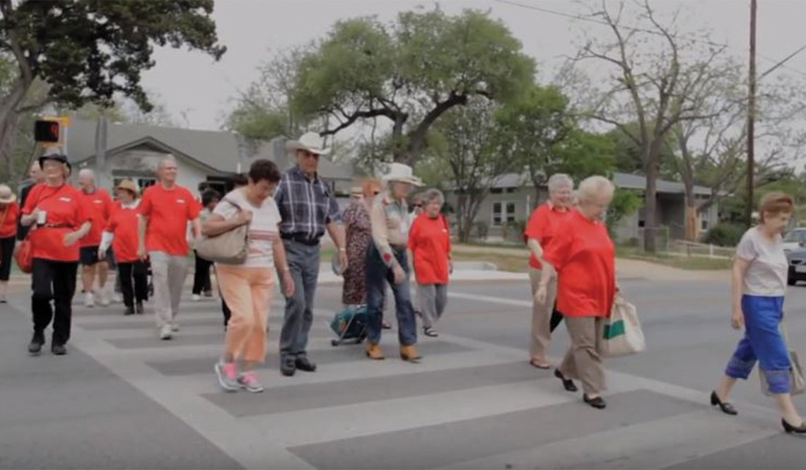 Older residents of South Austin, Texas, use a crosswalk they advocated to have installed.