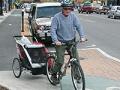 Senior man riding a bike.