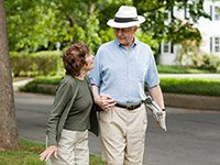 Senior couple walking in their neighborhood. Credit: Getty Images