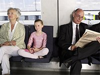 An older woman, young girl and older man ride public transportation.
