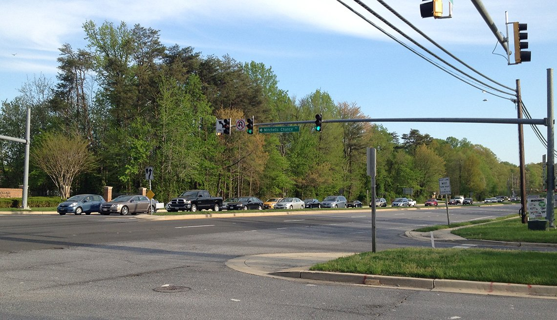 A wide, multi-lane roadway with no safe way for crossing on foot.
