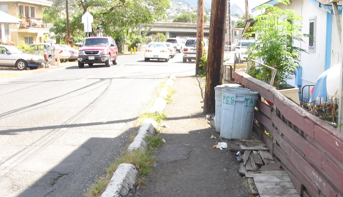 This residential roadway in Honolulu includes a shabby, not very safe sidewalk.
