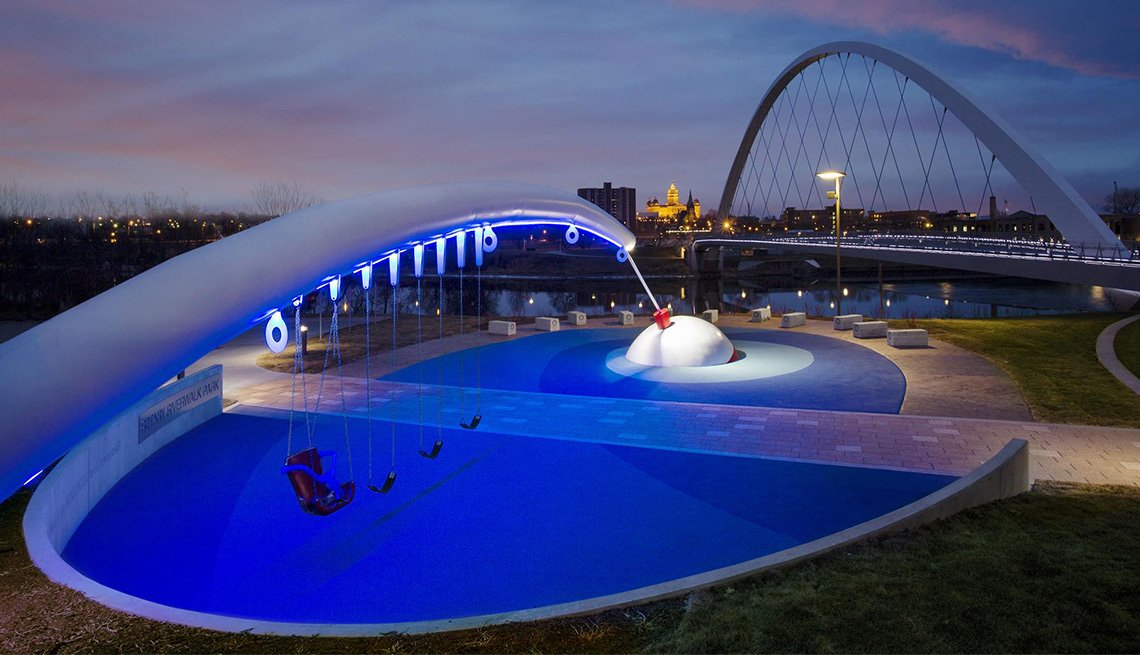 A nighttime photo of the fishing-rod themed Rotary Riverwalk Park in Des Moines, Iowa