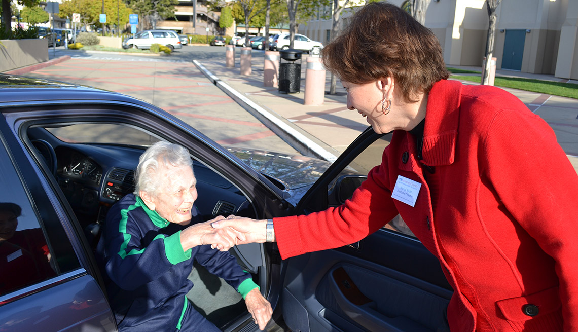 A Mature Woman Helps An Elderly Woman Out Of The Car, Street, Livable Communities, 5 Questions For Katherine Freund