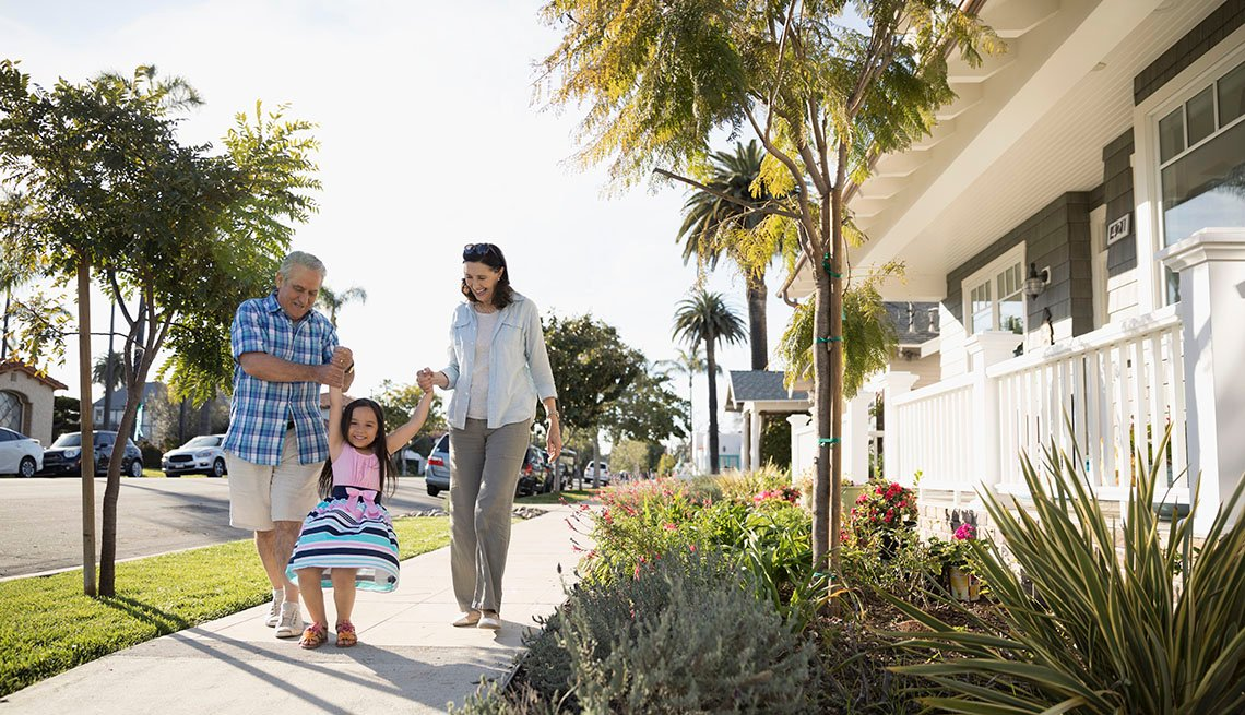 Grandparent Walks With Granddaughter And Adult Daughter, Sidewalk, Neighborhood, USA, Residence, Houses, AARP Livable Communities, 13 Solutions For A More Walkable America