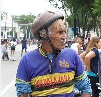 An older man rides a bicycle during Guadalajara, Mexico's RecreActiva