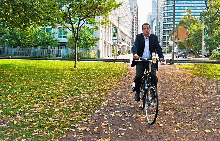 Livability advocate Gil Penalosa rides a bicycle in Toronto