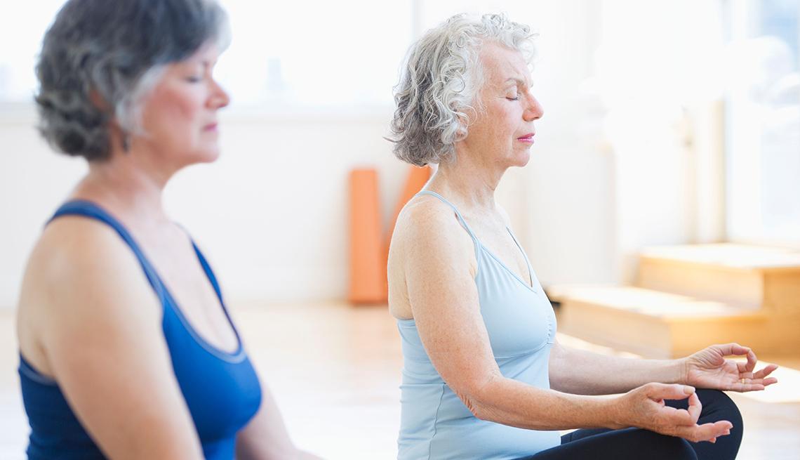Two Senior Women Practicing Yoga, AARP Livable Communities, Building A Community For A Lifetime