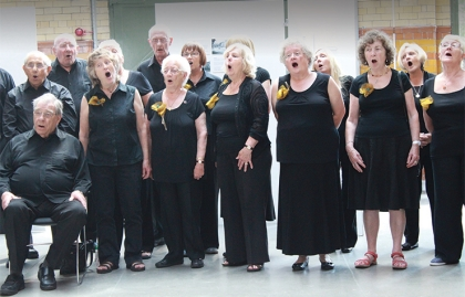 Older adults sing in a choir in Manchester, England