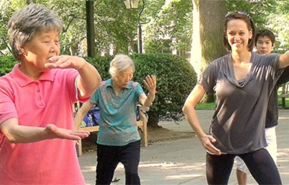 Older Asian women and younger people do tai chi in Philadelphia