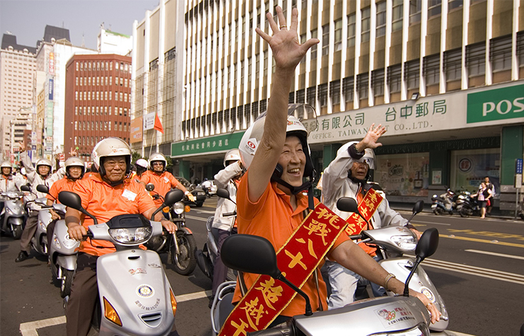 Older motorcyclists in Taiwan's Grandriders tour