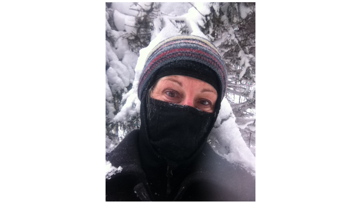 Woman Poses With Snowy Trees In Background Wearing Ski Mask, Livable Communities, Why Older Adults Should Go Car-Free
