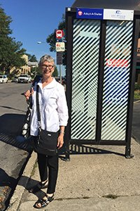 Patricia Blakely waits for a bus