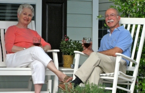 Louise and Dick Goodman sit on their front porch.