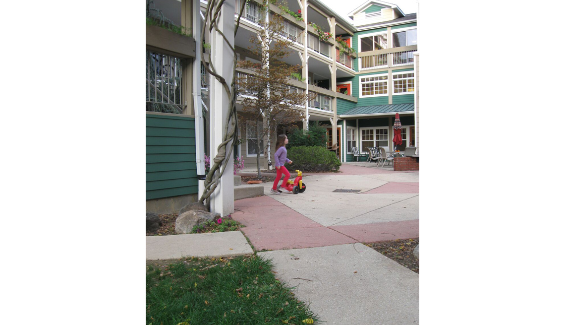 Girl Plays In Courtyard, Residences, Co-Housing, Livable Communities
