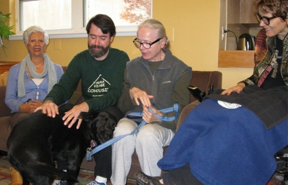 Residents of Takoma Park Cohousing gather in the common room