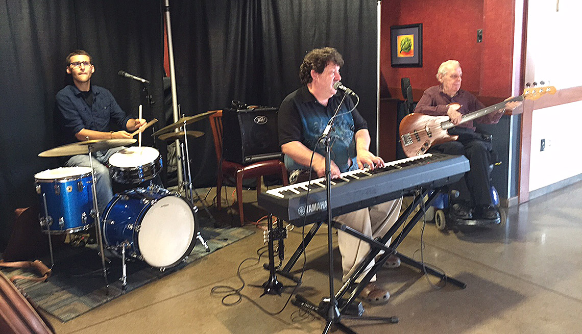 A Band Performs In A Music Hall Or Community Center, Keyboard, Drums, Guitar, How To Get People To Dance In Public, Livable Communities