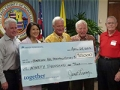 Representatives of Age-Friendly Honolulu pose with an oversized replica of a $90,000 donation check from Kaiser Permenante