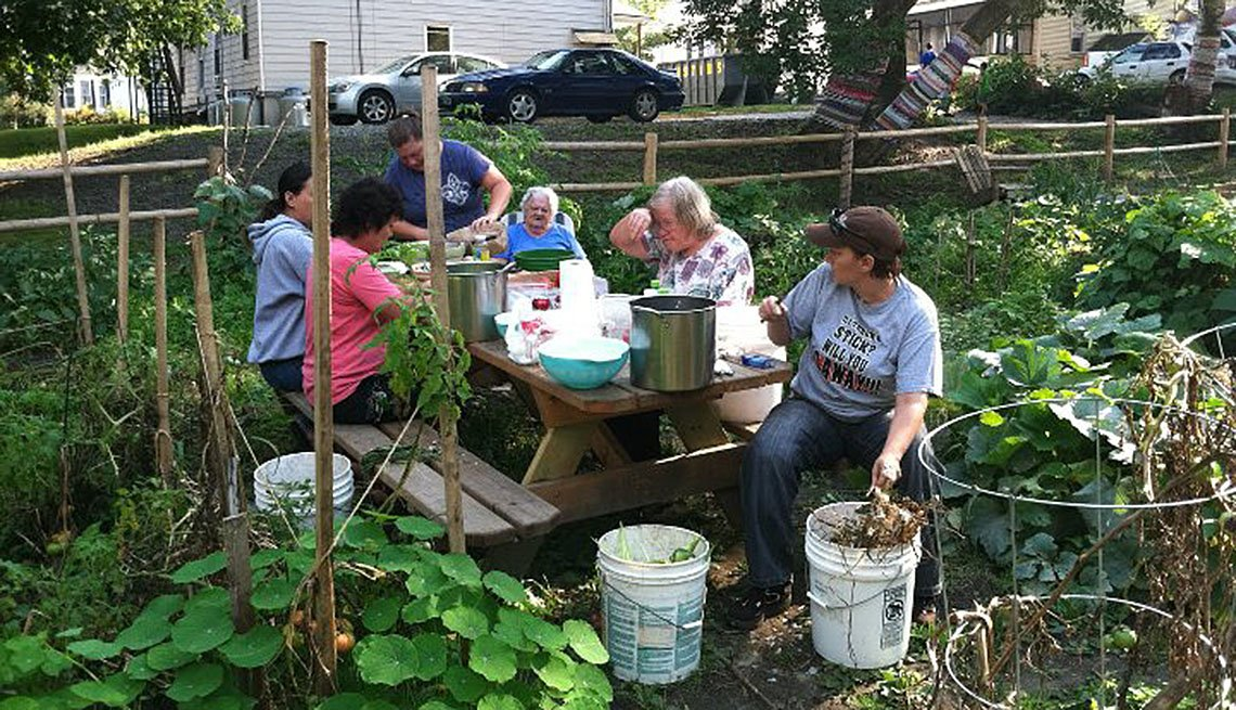 Neighbors Harvesting From Community Garden, How To Create And Maintain A Community Garden, Livable Communities