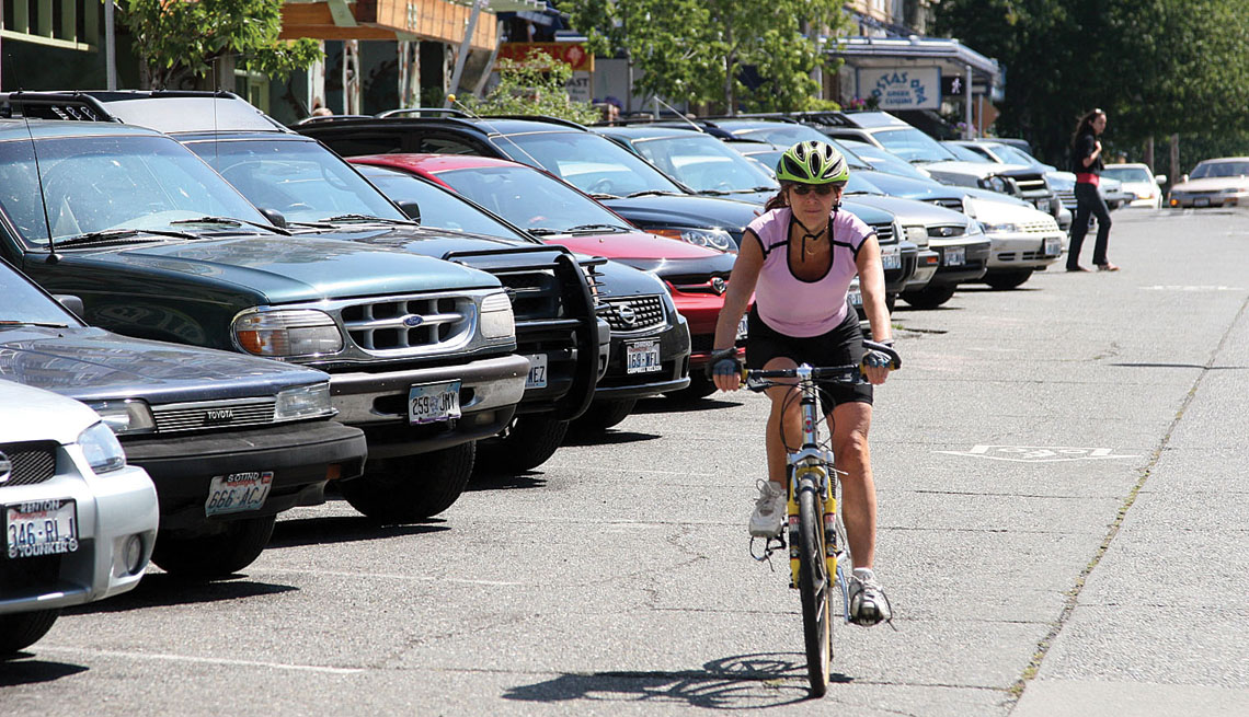 Head Out Diagonal Parking Spaces, Cars, Woman On Bicycle, Pedestrian, Livability Index, Livable Communities
