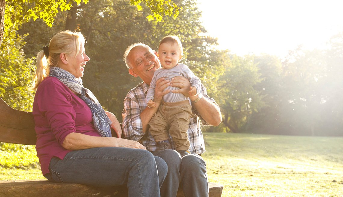 Grandparents Play With Grandson In Park, Trees, In Livable Communities Slideshow