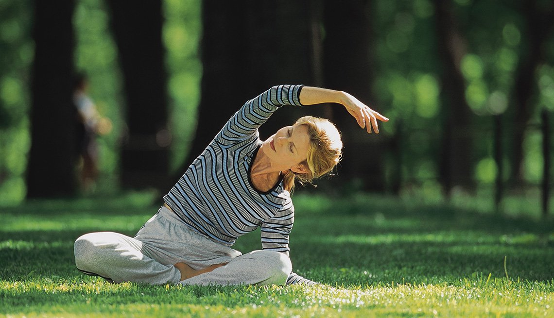 Woman Stretches And Practices Yoga In The Park, Exercise, Outdoors, Park, In Livable Communities Slideshow