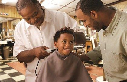 Three generations at a barber shop.