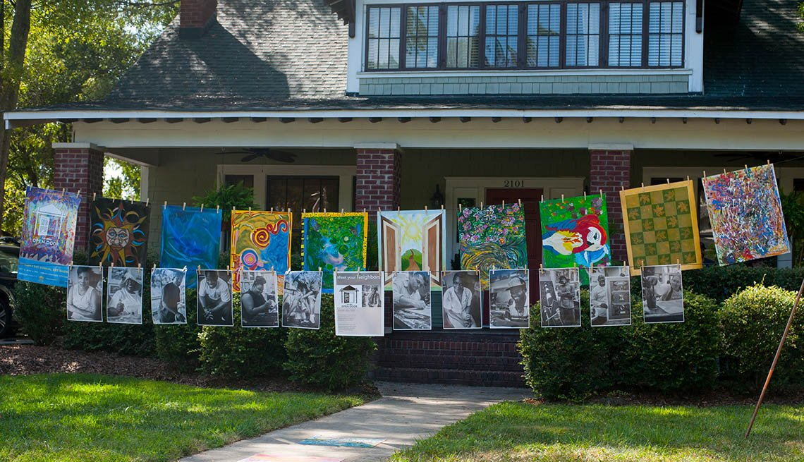 Artwork Hangs From Clothesline In Front Of House, Inspiring Livability Efforts, Livable Communities