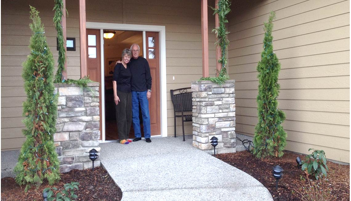 Take a Tour of Our Lifelong Home,  Sharon and Howard Johnson at front door