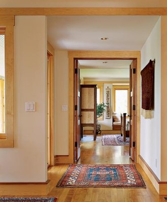 A wide access hallway and doorway to a main level bedroom.