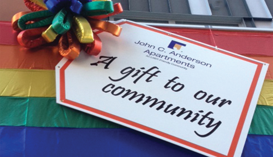 An oversized gift tag decorates the John C. Anderson Apartments