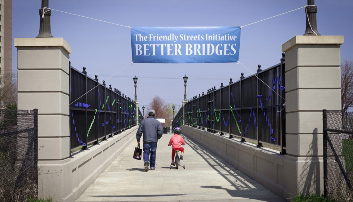 Father And Daughter On Bike Cross A Bridge, Friendly Streets Initiative, Livable Communities