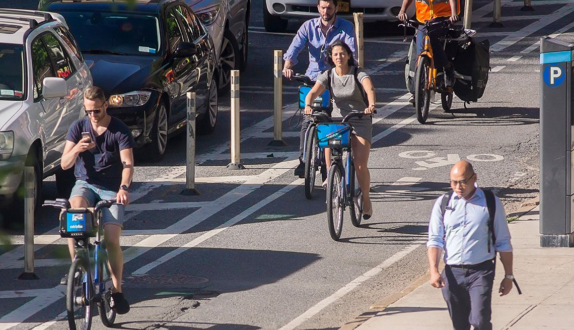 Pedestrians And Bicyclists On Busy City Street, Dedicated Bike Lanes, Parked Cars, Livable Communities, Bike Friendly Streets