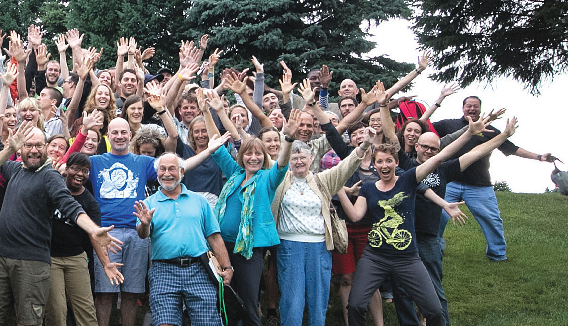 Group Portrait Of Smiling Men And Women Waving Hands, Outdoors, Biking And Walking Report, Livable Communities