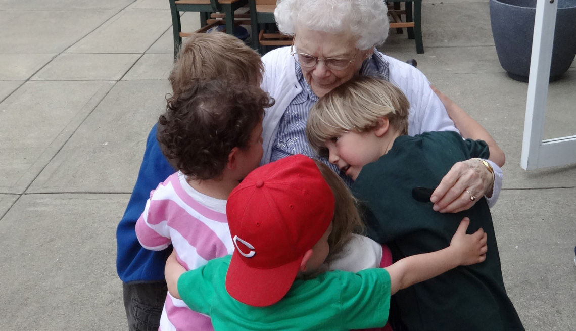Maple Knoll Village, Children Hugging Grandfriend, Elderly Woman, Livable Communities, Build Bonds Across Generations