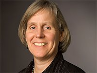 Mildred Warner is a professor of urban planning at Cornell University.