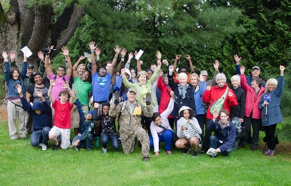 A group photo of adults and children from The International Schools in Cleveland, Ohio