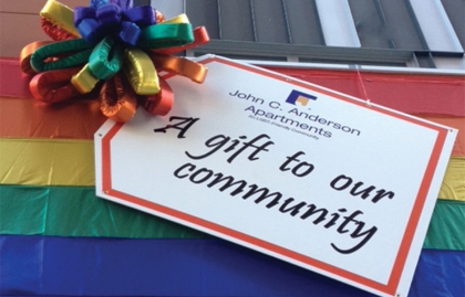 An oversized gift tag decorates the front of the John C. Anderson Apartments