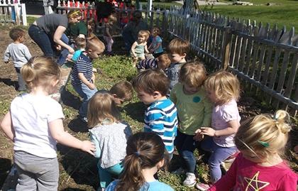 Preschoolers play in the garden of the JCC Community Garden in Louisville, Kentucky