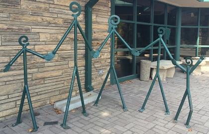 A bicycle rack sculpture shaped like a stick-figure family of five, Loveland, Colorado