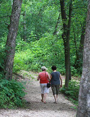 Two women walking in the woods of Dakota County, Minnesota